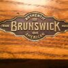 Brunswick plate logo on rail