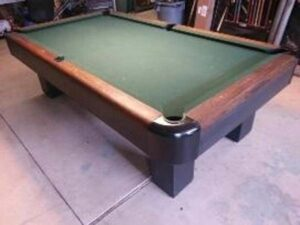 Sportsman pool table from the Brunswick-Balke-Collender company. A true antique classic pool table that will continue to be a prized piece for centuries to come.