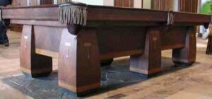 Brunswick Balke Collender Conqueror six leg pool table sitting in our shop and ready for sale.