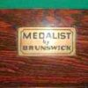 Rare 'medalist' plaque for the brunswick label on a Medalist pool table.