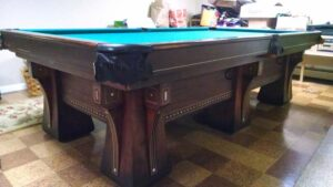 Brunswick-Balke-Collender Arcade pool table with 6 legs.