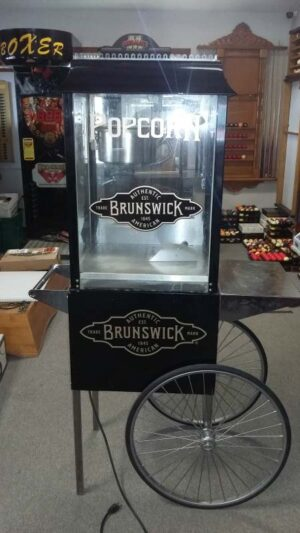 Brunswick automatic popcorn machine in black.