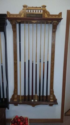 Brunswick Exposition novelty cue rack on the wall in our shop.