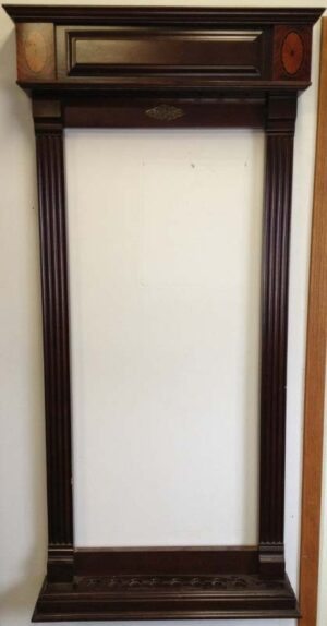Windsor cue rack from Brunswick billiards shown on our wall.